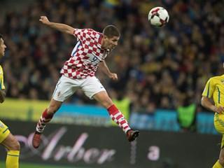 Kramarić brace secures Croatia play-off spot