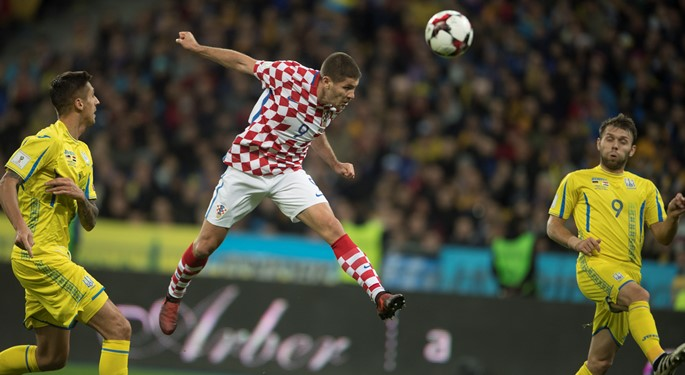 Kramarić brace secures Croatia play-off spot